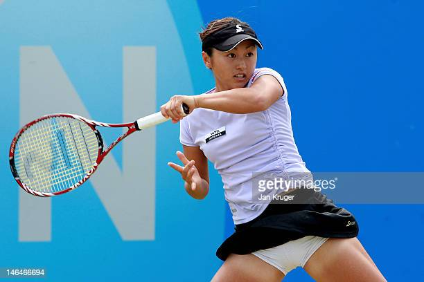 Misaki Doi of Japan hits a return during her quarter final match against Jelena Jankovic of Serbia during day seven of the AEGON Classic at Edgbaston...