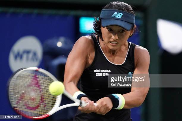 Misaki Doi of Japan hits a return shot against Kristina Mladenovic of France during day two of the Toray Pan Pacific Open at Utsubo Tennis Cent on...