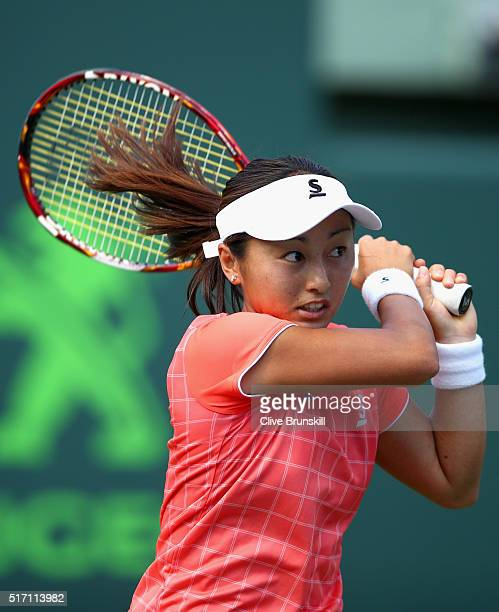 Misaki Doi of Japan in action against Christina McHale of the United States in their first round match during the Miami Open Presented by Itau at...