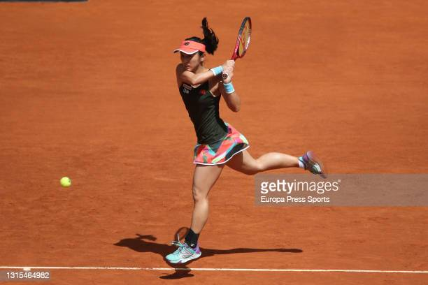 Misaki Doi of Japan in action during his Women's Singles match against Naomi Osaka of Japan on day two of the WTA 1000 - Mutua Madrid Open 2021 at La...