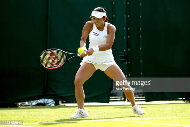 Misaki Doi of Japan plays a backhand during her ladies singles match against Arina Rodinova of Australia during qualifying prior to The Championships...