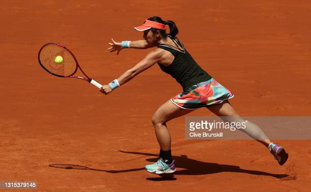 Misaki Doi of Japan plays a backhand in her first round match against Naomi Osaka of Japan during day two of the Mutua Madrid Open Tennis at La Caja...