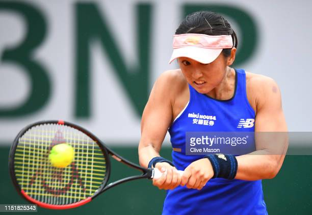 Misaki Doi of Japan plays a backhand in her ladies singles first round match against Sloane Stephens of The United States during Day one of the 2019...