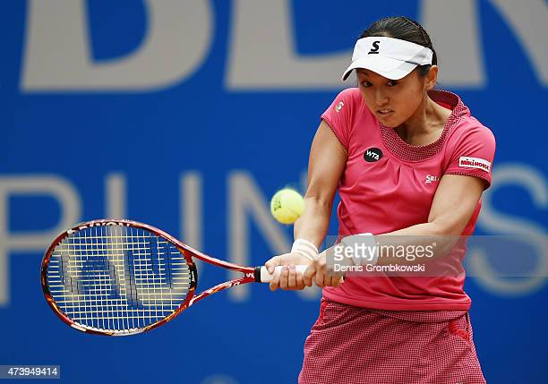 Misaki Doi of Japan plays a backhand in her match against Shuai Zhang of China during Day Three of the Nuernberger Versicherungscup 2015 on May 19...