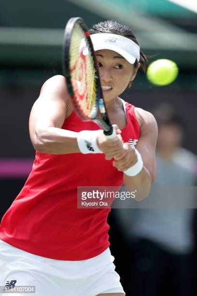 Misaki Doi of Japan plays a backhand in her singles match against Bibiane Schoofs of the Netherlands on day two of the Fed Cup World Group II...