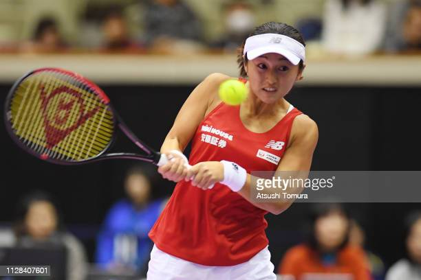 Misaki Doi of Japan plays a backhand in her Women's Singles match against Georgina GarciaPerez of Spain on day one of the Fed Cup World Group II...