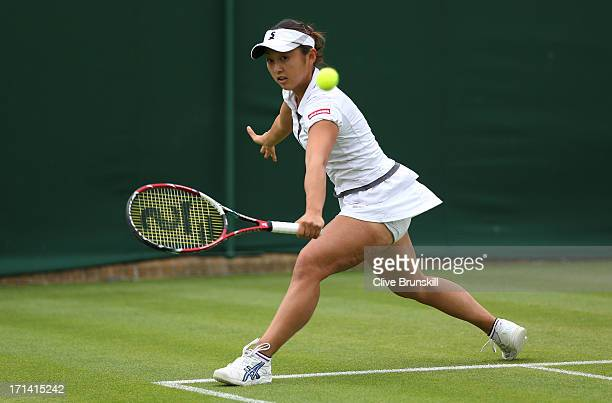 Misaki Doi of Japan plays a backhand in her Women's Singles match against Silvia Soler Espinosa of Spain on day one of the Wimbledon Lawn Tennis...