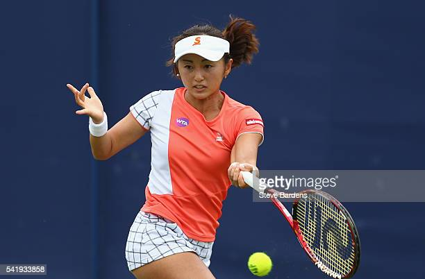 Misaki Doi of Japan plays a forehand during her second round women's singles match against Polona Herzog of Slovenia on day three of the WTA Aegon...