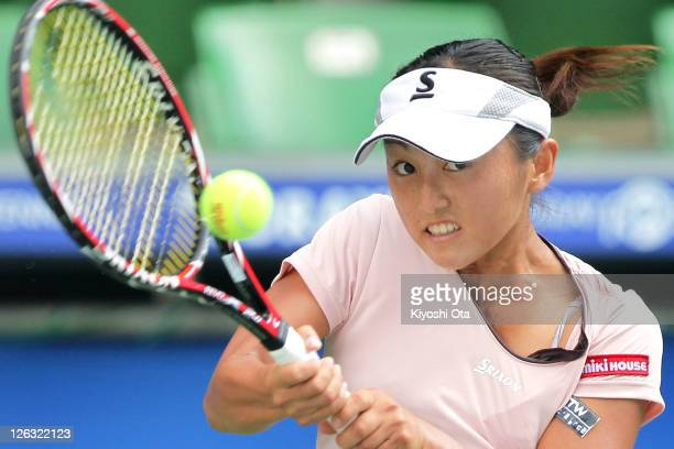 Misaki Doi of Japan plays a forehand in her match against Agnieszka Radwanska of Poland during the day one of the Toray Pan Pacific Open at Ariake...