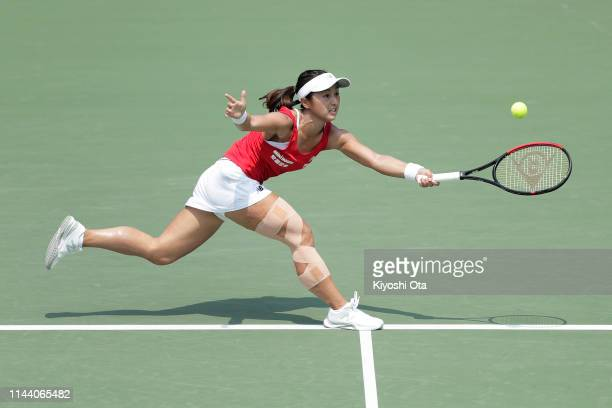 Misaki Doi of Japan plays in her singles match against Bibiane Schoofs of the Netherlands on day two of the Fed Cup World Group II Playoff between...
