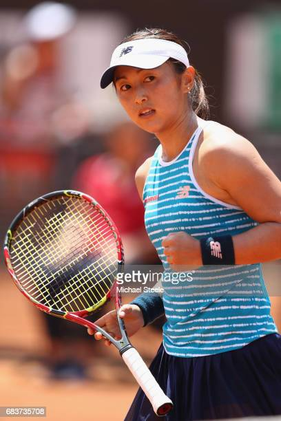 Misaki Doi of Japan reacts after winning a game during her first round match against Catherine Bellis of USA on Day Three of The Internazionali BNL...