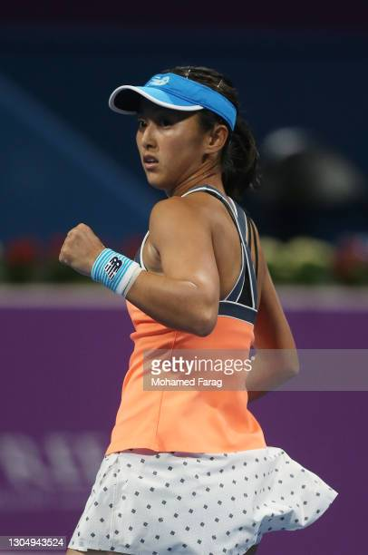 Misaki Doi of Japan reacts during the Women's Singles match between Saisai Zheng and Misaki Doi on Day Two of the WTA Qatar Total Open at Khalifa...
