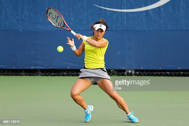 Misaki Doi of Japan returns a shot against Daniela Hantuchova of Slovakia in their Women's Singles First Round match on Day One of the 2015 US Open...