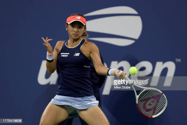 Misaki Doi of Japan returns a shot against Madison Keys of United States during Women's Singles first round match on day one of the 2019 US Open at...
