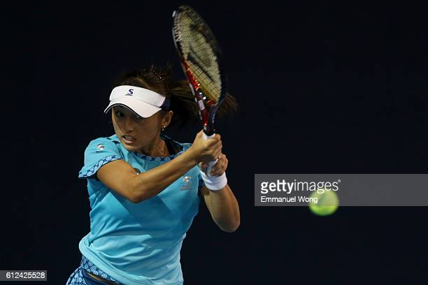 Misaki Doi of Japan returns a shot against Svetlana Kuznetsova of Russia during the Women's singles second round match on day four of the 2016 China...