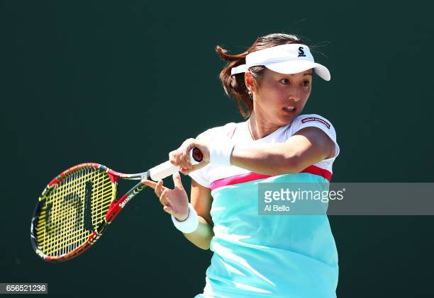 Misaki Doi of Japan returns a shot against Veronica Cepede Royg of Paraguay during day 3 of the Miami Open at Crandon Park Tennis Center on March 22...