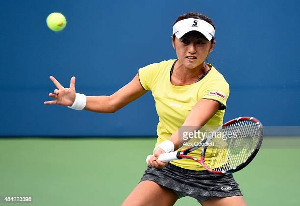 Misaki Doi of Japan returns a shot against Victoria Azarenka of Belarus during their women's singles first round match on Day Two of the 2014 US Open...