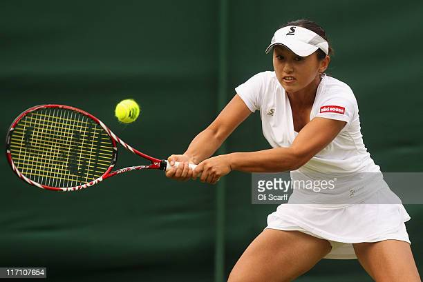 Misaki Doi of Japan returns a shot during her first round match against Bethanie MattekSands of the United States on Day Three of the Wimbledon Lawn...