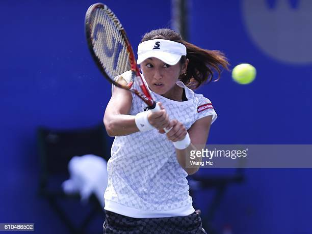 Misaki Doi of Japan returns a shot during the match against Anastasia Pavlyuchenkova of Russia on Day 2 of 2016 Dongfeng Motor Wuhan Open at Optics...