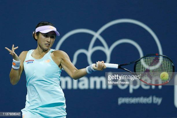 Misaki Doi of Japan returns a shot to Polona Hercog of Slovenia during Day 5 of the Miami Open Presented by Itau at Hard Rock Stadium on March 22...