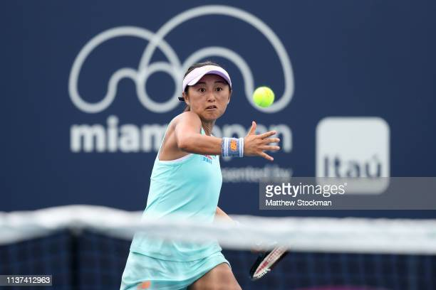 Misaki Doi of Japan returns a shot to Xinyu Wang of China during the Miami Open Presented by Itau at Hard Rock Stadium March 21 2019 in Miami Gardens...