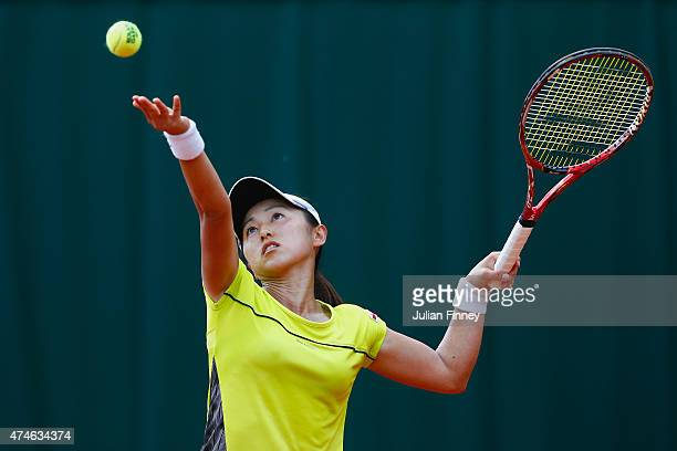 Misaki Doi of Japan serves during her Women's Singles match against Petra Cetkovska of France on day one of the 2015 French Open at Roland Garros on...