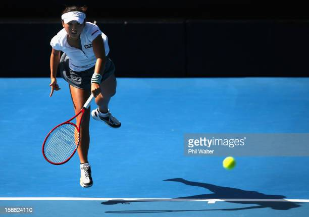 Misaki Doi of Japan serves in her first round match against Johanna Larsson of Sweden during day one of the 2013 ASB Classic on December 31 2012 in...