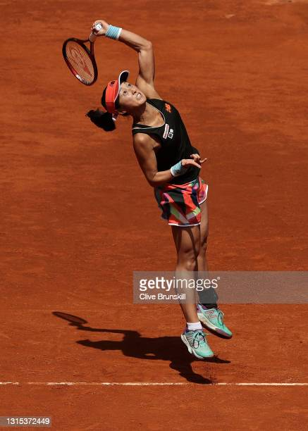 Misaki Doi of Japan serves in her first round match against Naomi Osaka of Japan during day two of the Mutua Madrid Open Tennis at La Caja Magica on...