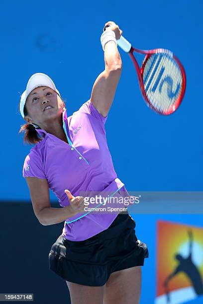Misaki Doi of Japan serves in her first round match against Petra Martic of Croatia during day one of the 2013 Australian Open at Melbourne Park on...