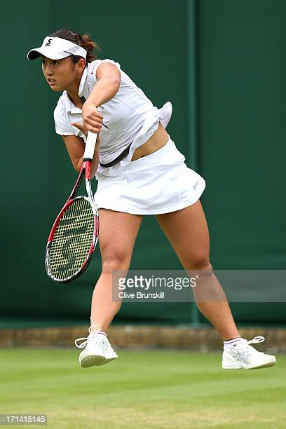 Misaki Doi of Japan serves in her Women's Singles match against Silvia Soler Espinosa of Spain on day one of the Wimbledon Lawn Tennis Championships...