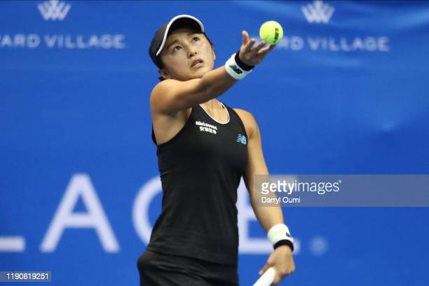 Misaki Doi of Japan tosses the ball while serving during the semifinal match of the Hawaii Tennis Open against Angelique Kerber of Germany at the...