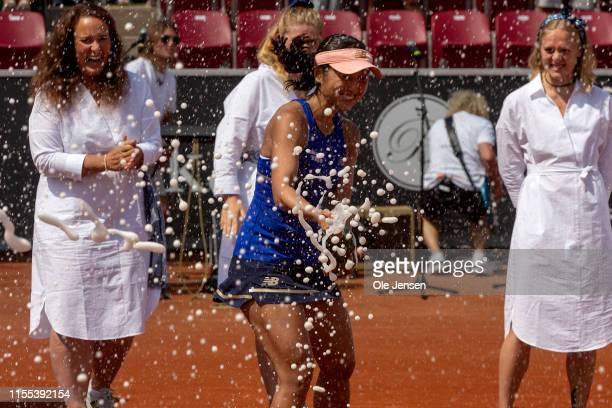 Misaki Doi of Japan wins the 2019 Swedish Open WTA for singles and celebrates the victory with spraying champagne on July 13 2019 in Bastad Sweden...