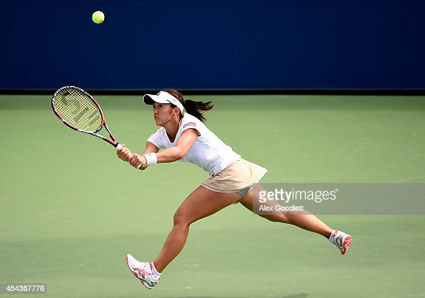 Misaki Doi of Japan with her partner Elina Svitolina of the Ukraine during a second round women's doubles match against Gabriela Dabrowski of Canada...