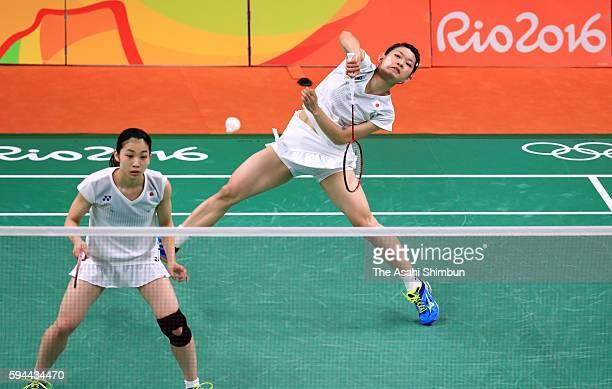 Misaki Matsutomo and Ayaka Takahashi of Japan celebrate a point against Christinna Pedersen and Kamilla Rytter Juhl of Denmark during the Women's...