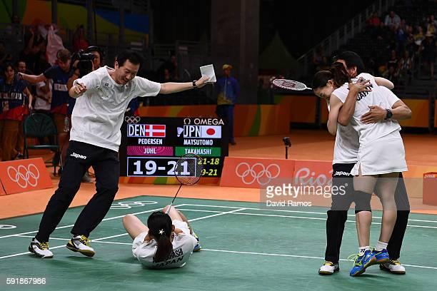 Misaki Matsutomo and Ayaka Takahashi of Japan celebrate winning match point against Christinna Pedersen and Kamilla Rytter Juhl of Denmark during the...