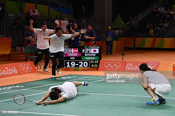Misaki Matsutomo and Ayaka Takahashi of Japan celebrate winning match point against Christinna Pedersen and Kamilla Rytter Juhl of Denmark during the...