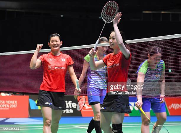 Misaki Matsutomo and Ayaka Takahashi of Japan celebrate winning the gold medals after the Women's Doubles final against Kim Hana and Kong Heeyoung of...