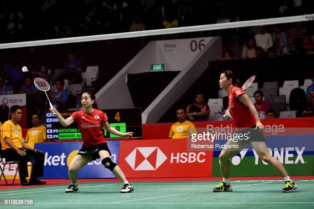 Misaki Matsutomo and Ayaka Takahashi of Japan compete against Chang Ye Na and Jung Kyung Eun of Korea during the Women's Doubles Quarter Final match...
