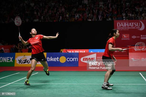 Misaki Matsutomo and Ayaka Takahashi of Japan compete against Greysia Polii and Apriyani Rahayu of Indonesia during the Women's Doubles Finals match...