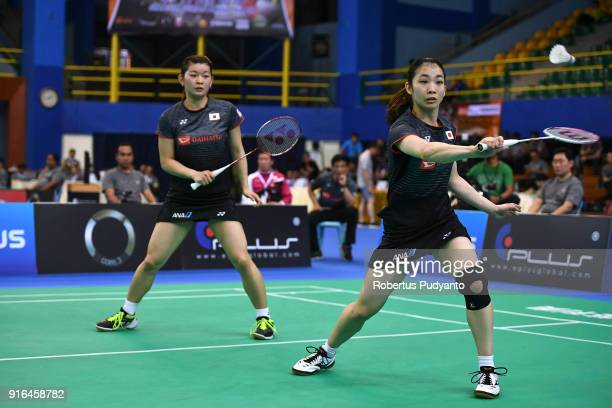Misaki Matsutomo and Ayaka Takahashi of Japan compete against Greysia Polii and Apriyani Rahayu of Indonesia during Women's Team Semifinal match...