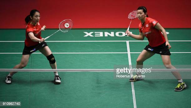 Misaki Matsutomo and Ayaka Takahashi of Japan competes against Kamilla Rytter Juhl and Christinna Pedersen of Denmark during the Women's Doubles Semi...