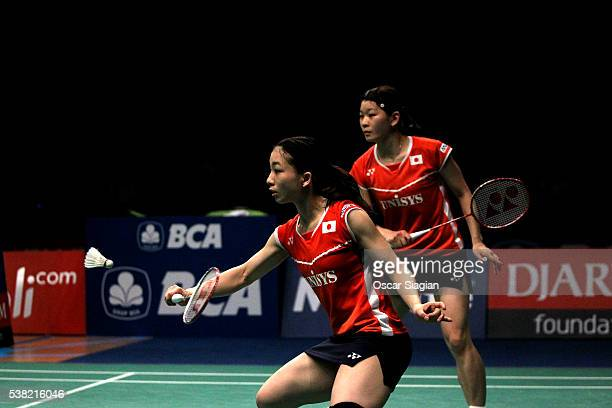 Misaki Matsutomo and Ayaka Takahashi of Japan in action during the 2016 Indonesia Open final match against Tang Yuanting and Yu Yang of China on June...
