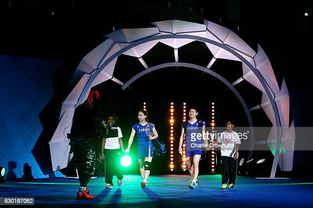 Misaki Matsutomo and Ayaka Takahashi of Japan make their way out to court ahead of the women's doubles final match against Chen Qingchen and Jia...