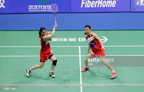 Misaki Matsutomo and Ayaka Takahashi of Japan play a return against Dong Wenjing and Feng Xueying of China during their women's doubles first round...