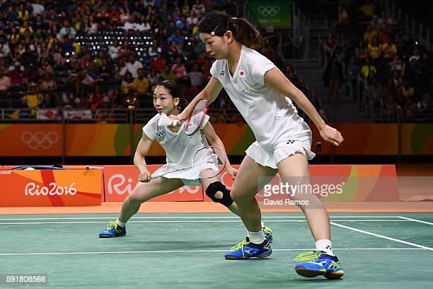 Misaki Matsutomo and Ayaka Takahashi of Japan play a shot against Christinna Pedersen and Kamilla Rytter Juhl of Denmark during the Women's Doubles...