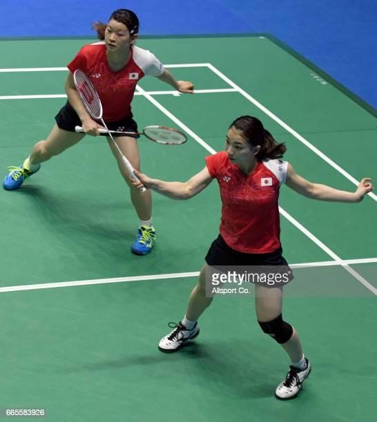 Misaki Matsutomo and Ayaka Takahashi of Japan plays a return shot to Huang Dongping and Li Yinhui of China during the quater finals of the 2017 World...
