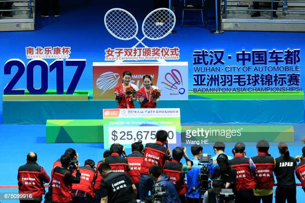 Misaki Matsutomo and Ayaka Takahashi of Japan pose with their gold medals on the podium after winning the their women's doubles final match against...