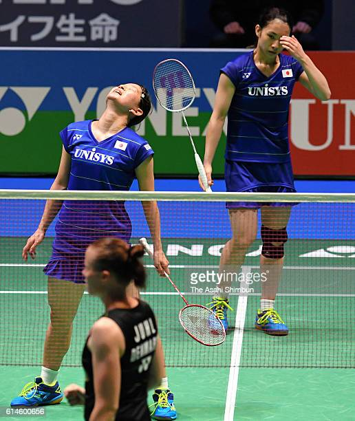 Misaki Matsutomo and Ayaka Takahashi of Japan react a point in the Women's Doubles final against Christinna Pedersen and Kamilla Rytter Juhl of...