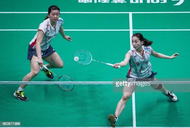 Misaki Matsutomo and Ayaka Takahashi of Japan returns to Yuki Fukushima and Sayaka Hirota of Japan during their women's doubles final match at the...