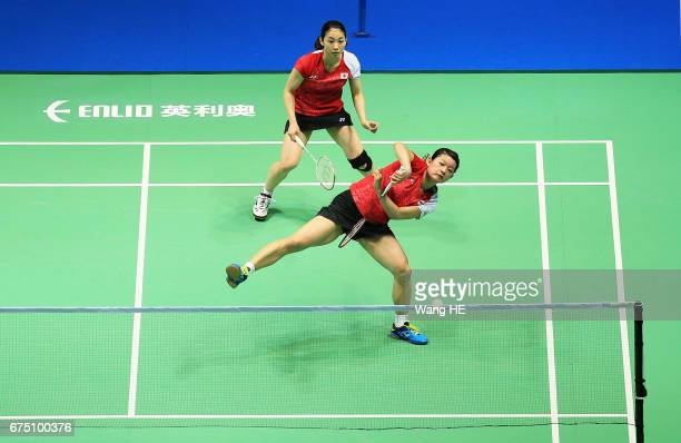 Misaki Matsutomo of Japan hits a return next to her partner Ayaka Takahashi during their women's doubles final match against Eye Rim KIM and YOO Have...